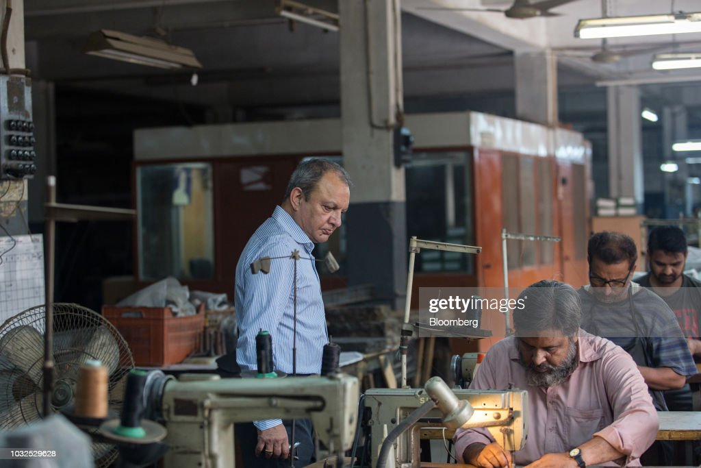 Omer Yusuf, managing director of Lyra Ltd., observes workers at the company's factory in Karachi, Pakistan, on Thursday, Aug. 16, 2018. 'It's going to be tough. But they've got a good team, Asad Umar is probably one of the most brilliant people I know -- I'm hopeful.' said Yusuf, who knew Pakistan's Finance Minister Asad Umar during his corporate days. Photographer: Asim Hafeez/Bloomberg via Getty Images