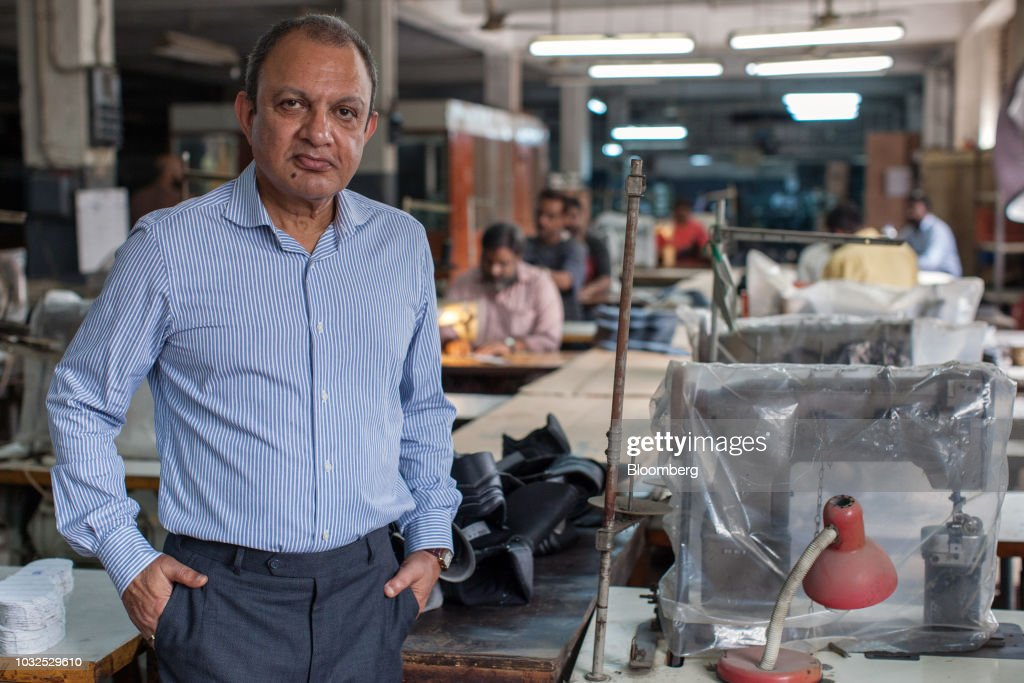 Omer Yusuf, managing director of Lyra Ltd., poses for a photograph inside the company's factory in Karachi, Pakistan, on Thursday, Aug. 16, 2018. 'It's going to be tough. But they've got a good team, Asad Umar is probably one of the most brilliant people I know -- I'm hopeful.' said Yusuf, who knew Pakistan's Finance Minister Asad Umar during his corporate days. Photographer: Asim Hafeez/Bloomberg via Getty Images