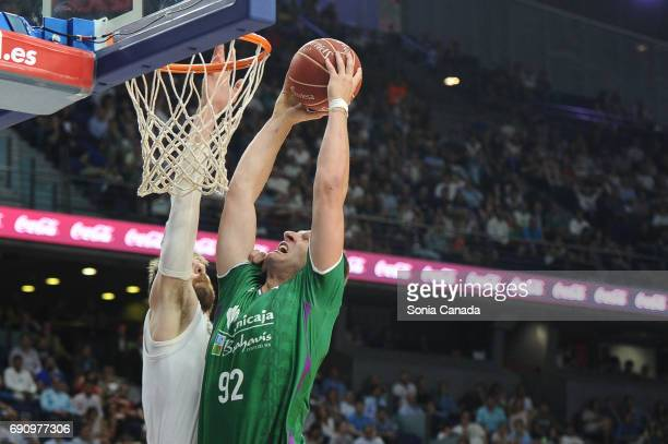 Omic #92 center of Unicaja and Andres 'Chapu' Nocioni #6 forward of Real Madrid during the Liga Endesa Semi Final game between Real Madrid and...