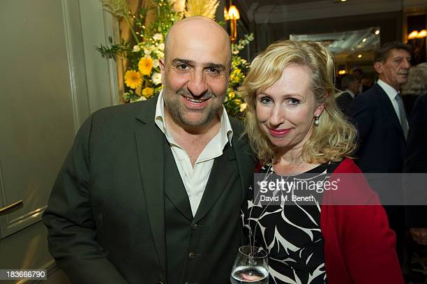 Omid Djalili and Annabel Knight attend Nicholas Parsons 90th birthday party at the Churchill Hotel on October 8 2013 in London England