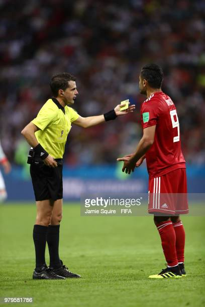 Omid Ebrahimi of Iran argues with referee Andres Cunha during the 2018 FIFA World Cup Russia group B match between Iran and Spain at Kazan Arena on...