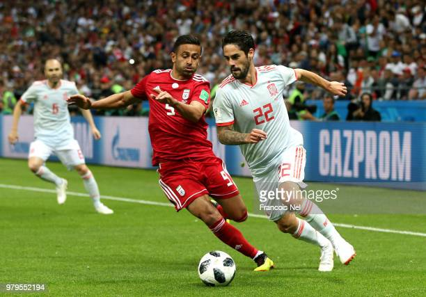 Omid Ebrahimi of Iran battles for possession with Isco of Spain during the 2018 FIFA World Cup Russia group B match between Iran and Spain at Kazan...