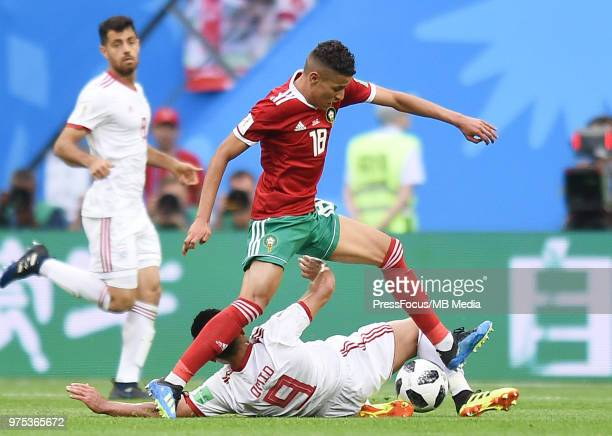 Omid Ebrahimi of Iran competes with Amine Harit of Morocco during the 2018 FIFA World Cup Russia group B match between Morocco and Iran at Saint...