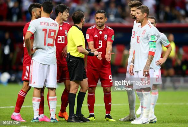 Omid Ebrahimi of Iran protests against referee Andres Cunha after he disallows Iran's first goal during the 2018 FIFA World Cup Russia group B match...