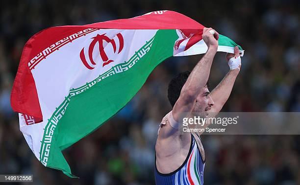 Omid Haji Noroozi of Islamic Republic of Iran celebrates beating Revaz Lashkhi of Georgia in their Men's GrecoRoman 60 kg Gold Medal bout on Day 10...