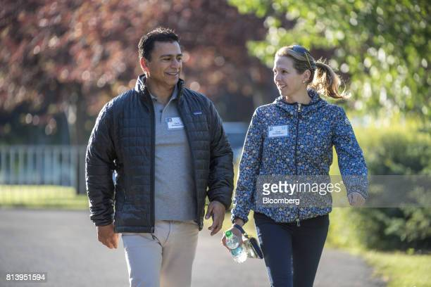 Omid Kordestani chairman of Twitter Inc left and Gisel Kordestani director of new business development for Google Inc arrive for the morning session...