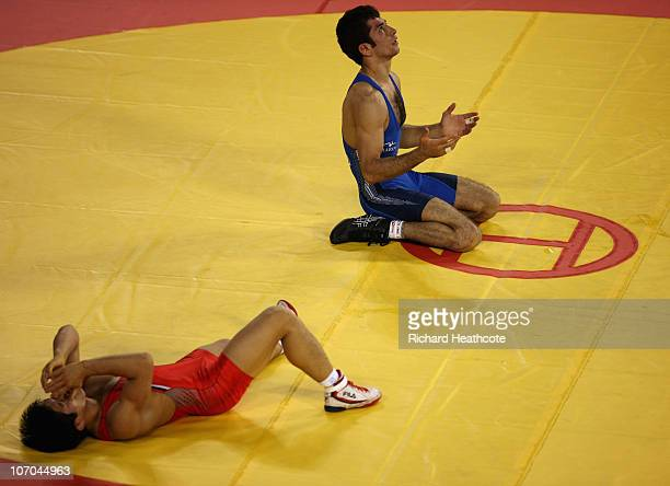 Omid Noroozi of Iran celebrates victory over Jihyun Jung of South Korea in the gold medal match during the Men's GrecoRoman 60kg Wrestling at Huagong...