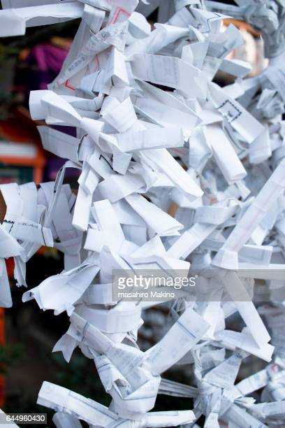 omikuji, fortune papers - invocation stock photos and pictures