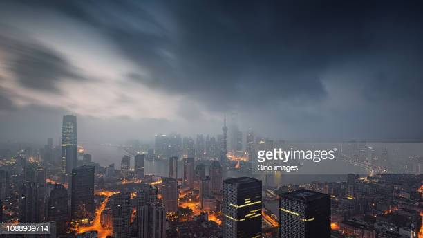 ominous cityscape at dusk, china - image stockfoto's en -beelden