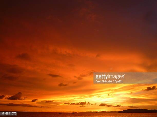 ominous clouds in orange sky - orange colour stock pictures, royalty-free photos & images