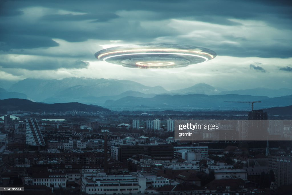 Ominous UFO above the city : Stock Photo