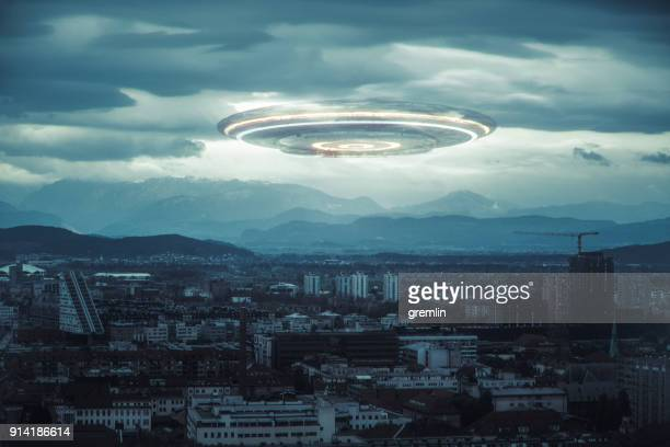 ominous ufo above the city - military invasion stock pictures, royalty-free photos & images