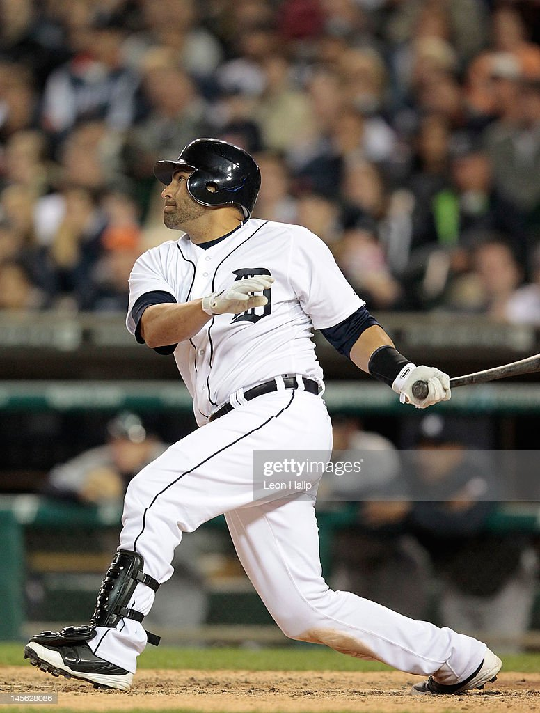 Omir Santos #18 of the Detroit Tigers hits a game winning sacrifice fly in the ninth inning scoring Brennan Boesch #26 during the game against the New York Yankees at Comerica Park on June 2, 2012 in Detroit, Michigan. The Tigers defeated the Yankees 4-3.