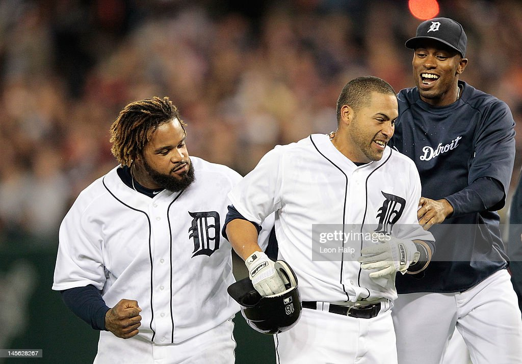 Omir Santos #18 of the Detroit Tigers hits a game winning sacrifice fly in the ninth inning scoring Brennan Boesch #26 and celebrates with his teammates Prince Fielder #28 and Austin Jackson #14 during the game against the New York Yankees at Comerica Park on June 2, 2012 in Detroit, Michigan. The Tigers defeated the Yankees 4-3.