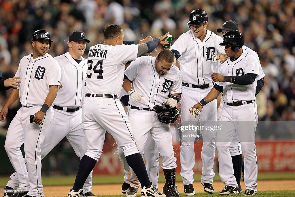 Omir Santos #18 of the Detroit Tigers is swarmed by his teammates after hitting a game winning sacrifice fly in the ninth inning scoring Brennan Boesch #26 during the game against the New York Yankees at Comerica Park on June 2, 2012 in Detroit, Michigan. The Tigers defeated the Yankees 4-3.