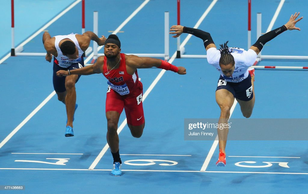 Omo Osaghae of the United States crosses the line to win the gold medal from silver medalist Pascal Martinot-Lagarde of France in the Men's 60m Hurdles Final during day three of the IAAF World Indoor Championships at Ergo Arena on March 9, 2014 in Sopot, Poland.