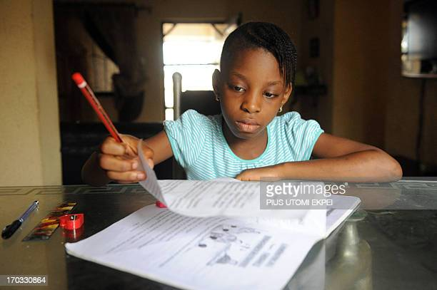 Omoze Ogwogho a pupil of the Christower International Schools one of Nigeria's private schools does her homework on June 8 2013 at home in the...