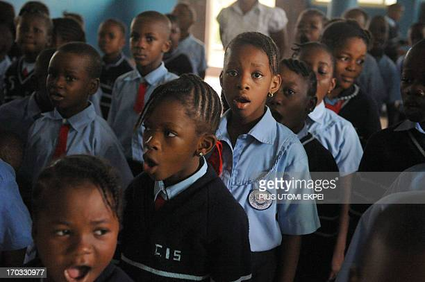 Omoze Ogwogho a pupil of the Christower International Schools one of Nigeria's private schools sings on June 6 2013 during morning assembly in the...