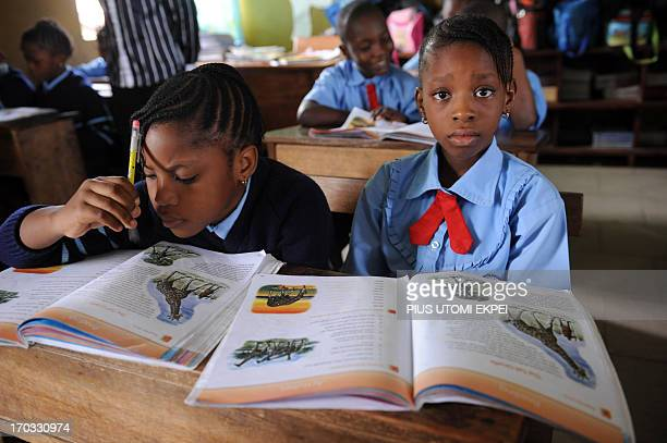 Omoze Ogwogho and classmate Skylar Oshotse attend class on June 6 2013 at the Christower International Schools one of Nigeria's private schools in...