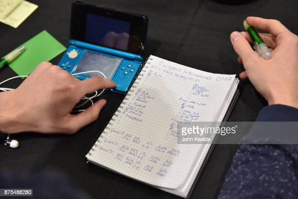 A ompetitor makes notes during the Pokemon European International Championships at ExCel on November 17 2017 in London England Thousands of...