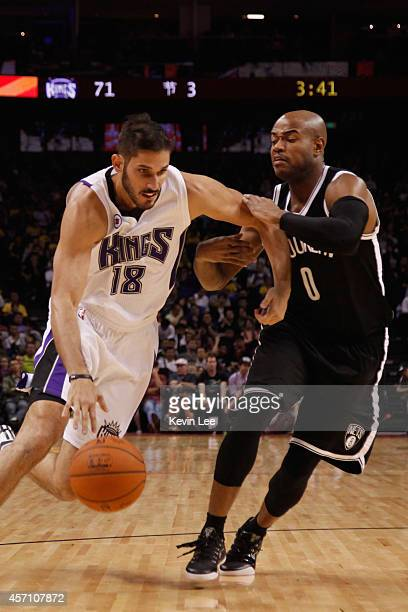 Omri Caspi of Sacramento Kings dribbles against Jarret Jack of Brooklyn Nets during the NBA Global Game 2014 at MercedesBenz Arena on October 12 2014...