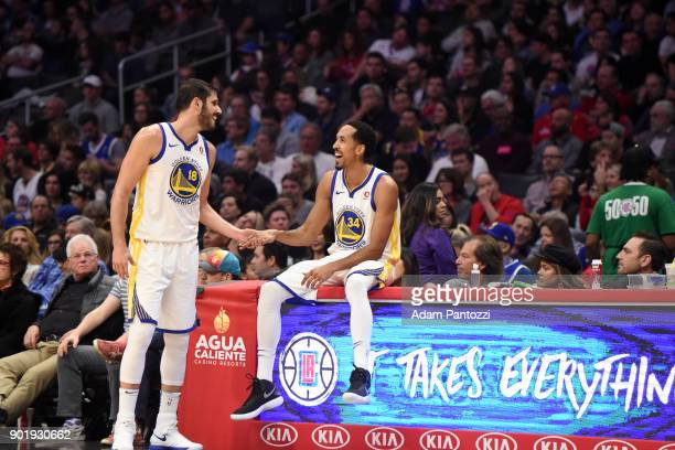 Omri Casspi and Shaun Livingston of the Golden State Warriors during the game against the LA Clippers on January 6 2018 at STAPLES Center in Los...