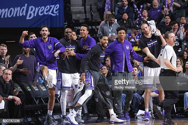 Omri Casspi Anthony Tolliver Skal Labissiere Garrett Temple Malachi Richardson and Kosta Koufos of the Sacramento Kings cheer on their teammates...