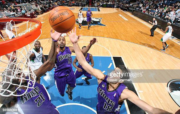 Omri Casspi Donte Greene and Kenny Thomas of the Sacramento Kings control the rebound against the Minnesota Timberwolves during the game on December...