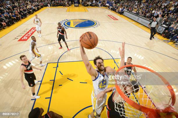 Omri Casspi of the Golden State Warriors drives to the basket against the Portland Trail Blazers on December 11 2017 at ORACLE Arena in Oakland...