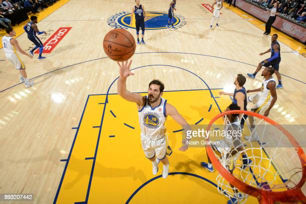 Omri Casspi of the Golden State Warriors grabs the rebound against the Dallas Mavericks on December 14 2017 at ORACLE Arena in Oakland California...