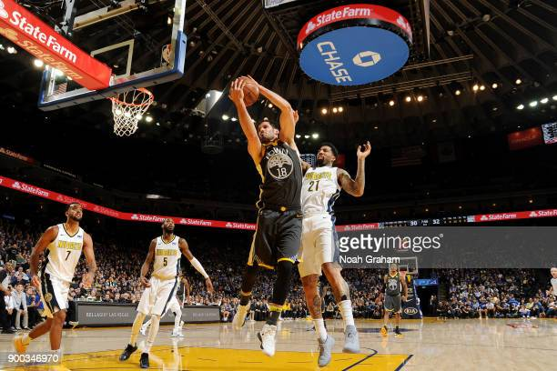 Omri Casspi of the Golden State Warriors grabs the rebound against the Denver Nuggets on December 23 2017 at ORACLE Arena in Oakland California NOTE...