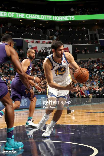 Omri Casspi of the Golden State Warriors handles the ball against the Charlotte Hornets on December 6 2017 at Spectrum Center in Charlotte North...