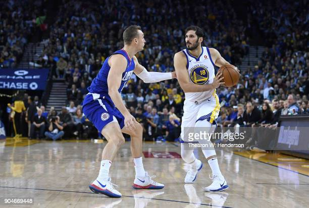 Omri Casspi of the Golden State Warriors looks to drive to the basket while closely guarded by Sam Dekker of the LA Clippers during the second half...