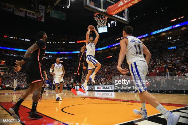 Omri Casspi of the Golden State Warriors looks to shoot against the Miami Heat at American Airlines Arena on December 3 2017 in Miami Florida NOTE TO...