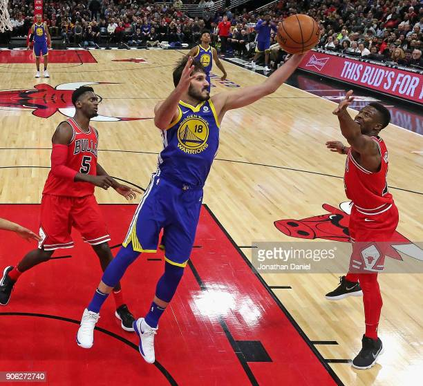 Omri Casspi of the Golden State Warriors rebounds between Bobby Portis and David Nwaba of the Chicago Bulls at the United Center on January 17 2018...