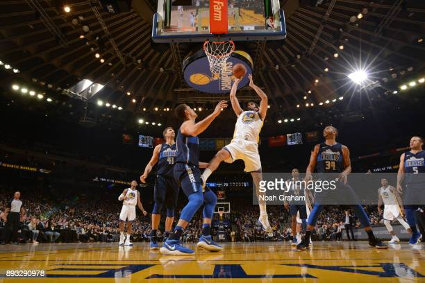 Omri Casspi of the Golden State Warriors shoots the ball against the Dallas Mavericks on December 14 2017 at ORACLE Arena in Oakland California NOTE...