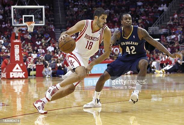 Omri Casspi of the Houston Rockets dribbles against Lance Thomas of the New Orleans Pelicans in a preseason NBA game on October 5 2013 at Toyota...