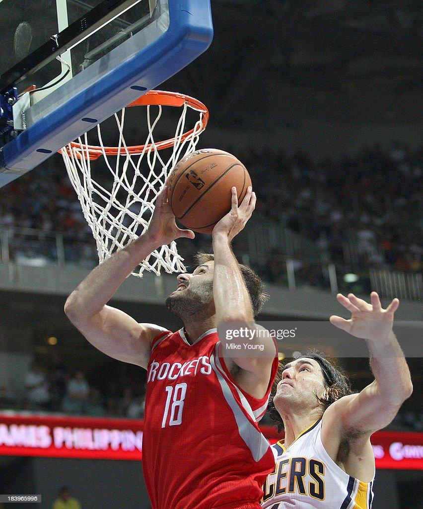 Omri Casspi #18 of the Houston Rockets drives to the hoop during the NBA game at the Mall of Asia Arena on October 10, 2013 in Manila, Philippines.