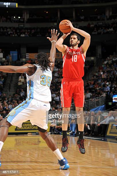 Omri Casspi of the Houston Rockets shoots against the Denver Nuggets on April 9 2014 at the Pepsi Center in Denver Colorado NOTE TO USER User...