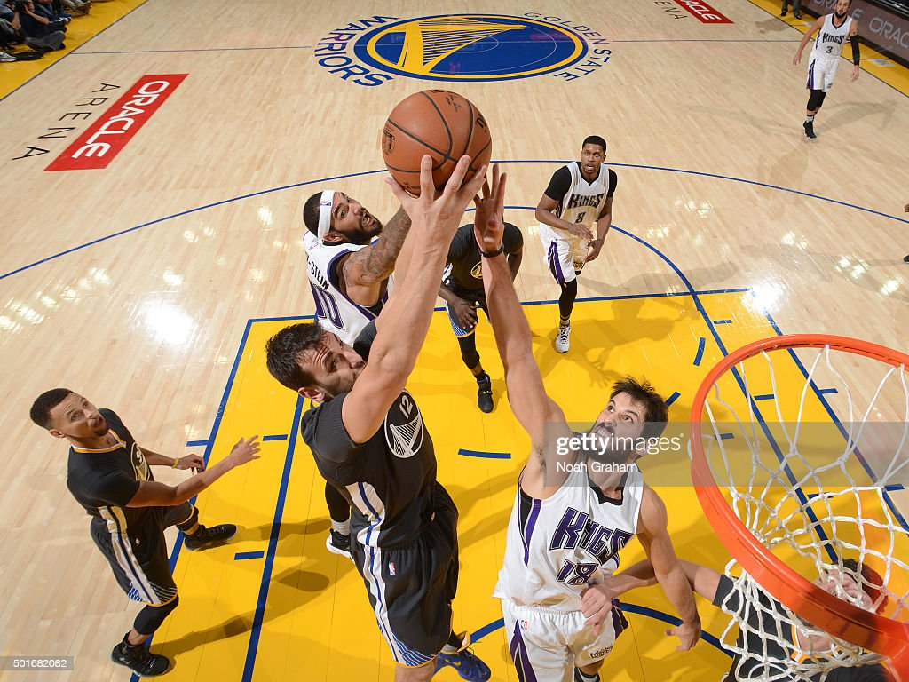 Omri Casspi #18 of the Sacramento Kings. Andrew Bogut #12 of the Golden State Warriors and Willie Cauley-Stein #00 of the Sacramento Kings go for the rebound on November 28, 2015 at ORACLE Arena in Oakland, California.