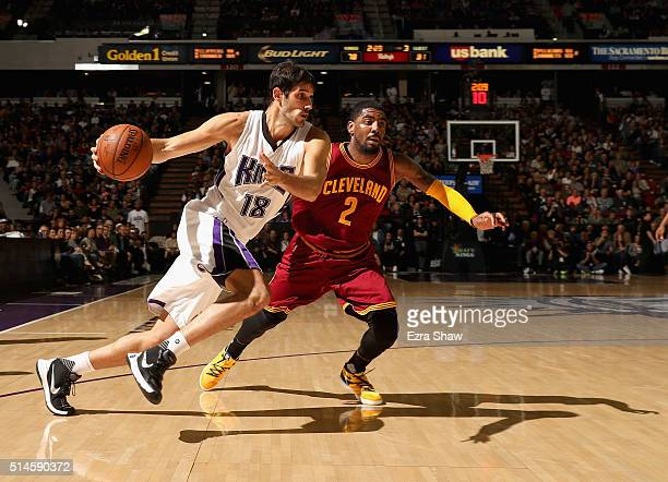 Omri Casspi of the Sacramento Kings drives on Kyrie Irving of the Cleveland Cavaliers at Sleep Train Arena on March 9 2016 in Sacramento California...
