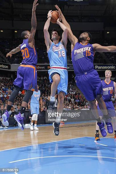 Omri Casspi of the Sacramento Kings goes to the basket against Archie Goodwin of the Phoenix Suns and Alan Williams of the Phoenix Suns on March 25...