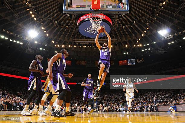 Omri Casspi of the Sacramento Kings goes up for a dunk against the Golden State Warriors on December 28 2015 at ORACLE Arena in Oakland California...