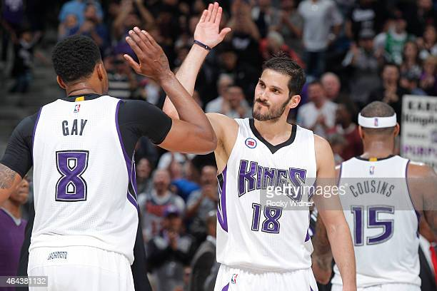 Omri Casspi of the Sacramento Kings high fives teammate Rudy Gay against the Boston Celtics on February 20 2015 at Sleep Train Arena in Sacramento...