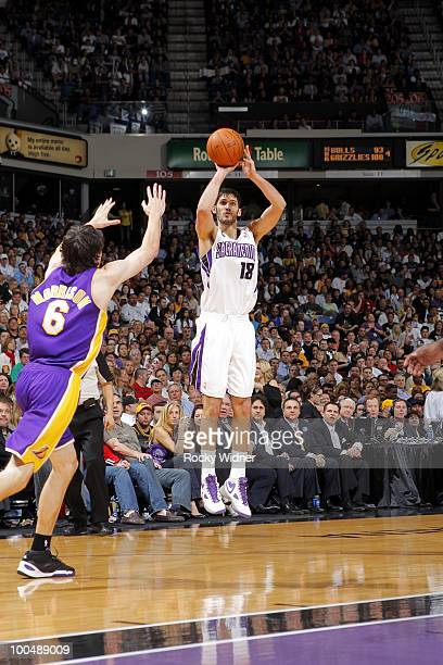 Omri Casspi of the Sacramento Kings shoots a jump shot against Adam Morrison of the Los Angeles Lakers during the game at Arco Arena on March 16 2010...