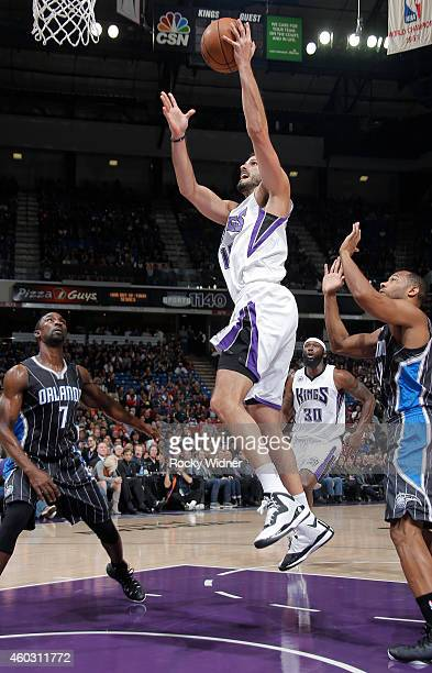 Omri Casspi of the Sacramento Kings shoots against the Orlando Magic on December 6 2014 at Sleep Train Arena in Sacramento California NOTE TO USER...