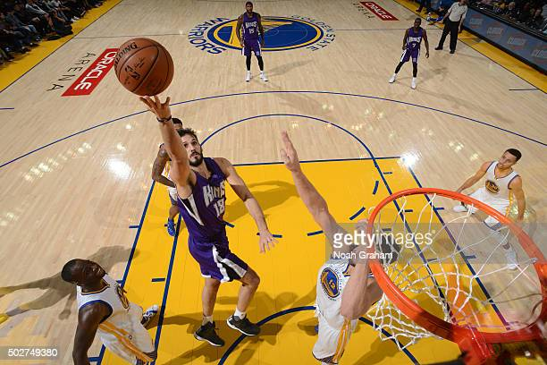 Omri Casspi of the Sacramento Kings shoots the ball against the Golden State Warriors on December 28 2015 at ORACLE Arena in Oakland California NOTE...
