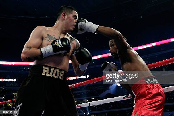 Omri Lowther lands a punch to the face against Brandon Rios during their Super Lightweight bout at Cowboys Stadium on November 13, 2010 in Arlington,...