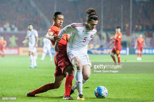 Omro Al Midani of Syria fights for the ball with Zhang Yuning of China PR during their 2018 FIFA World Cup Russia Final Qualification Round Group A...