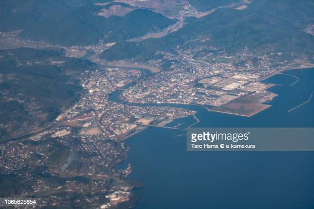 Omura Bay and Kawatana town in Nagasaki prefecture in Japan daytime aerial view from airplane
